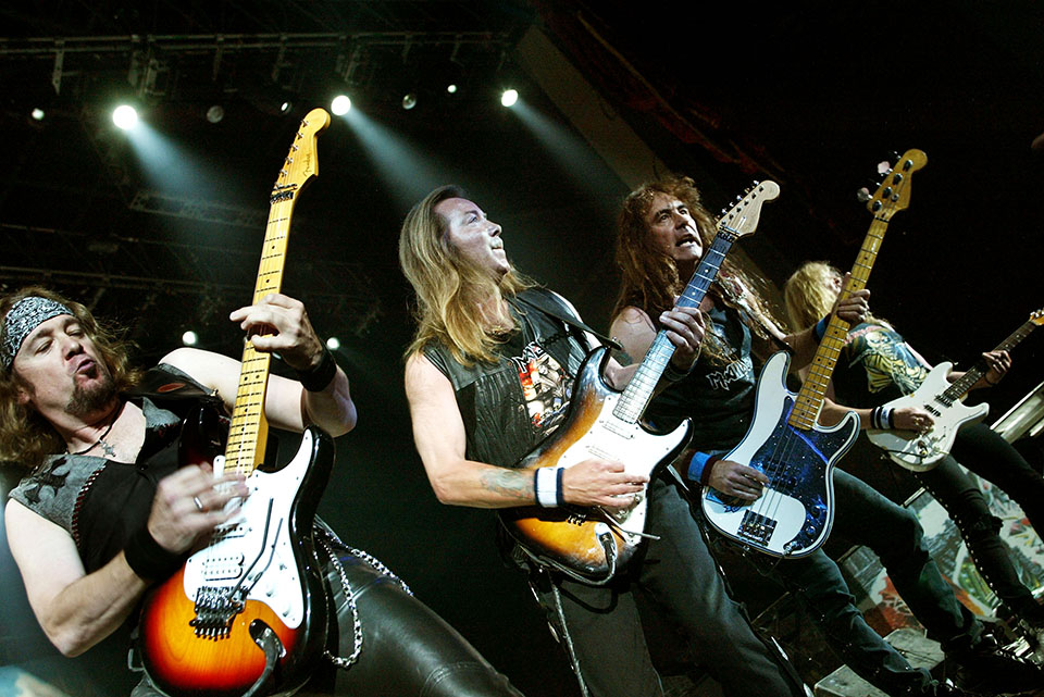 SAN BERNANDINO, CA - AUGUST 20: Guitarists Adrian Smith, Dave Murray, Steve Harris and Janick Gers of Iron Maiden performs at Ozzfest 2005 at the Hyundai Pavilion on August 20, 2005 in San Bernandino, California. (Photo by Karl Walter/Getty Images)